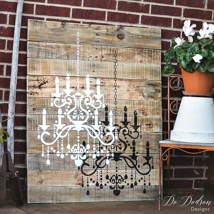 Just one wood pallet and a great stencil is all you will need to create this beautiful chandelier wall art.