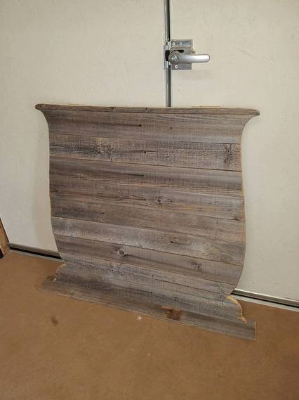 Repurposed fence boards for a custom back on an antique washstand.