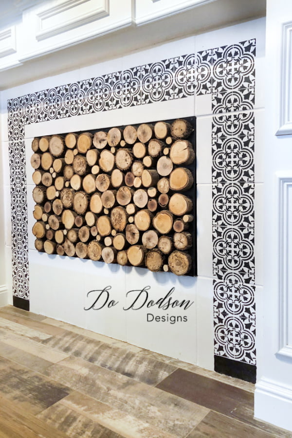 How about a wood slice fireplace cover. When you're in Texas, it's decor!