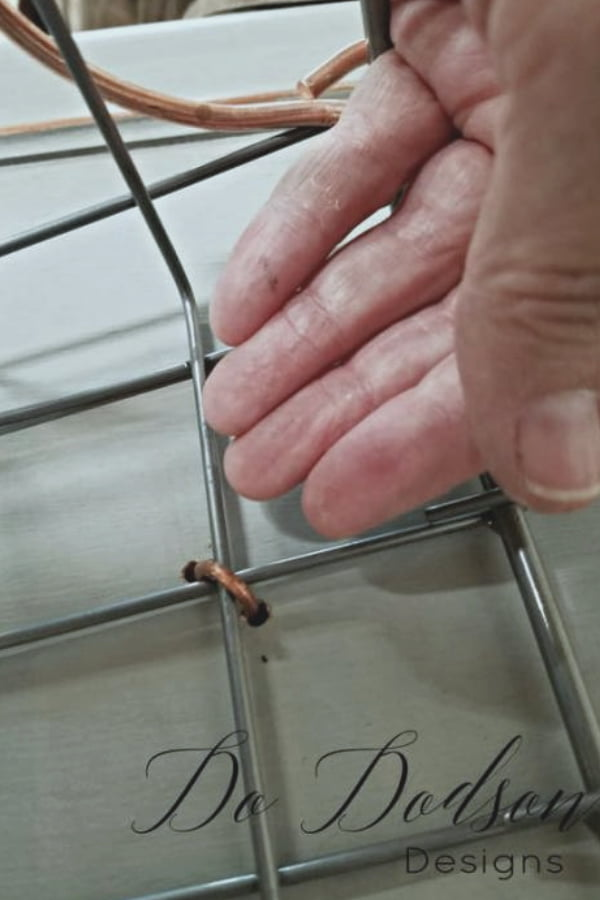 Use wire to secure the basket to the   back side of the cabinet door.