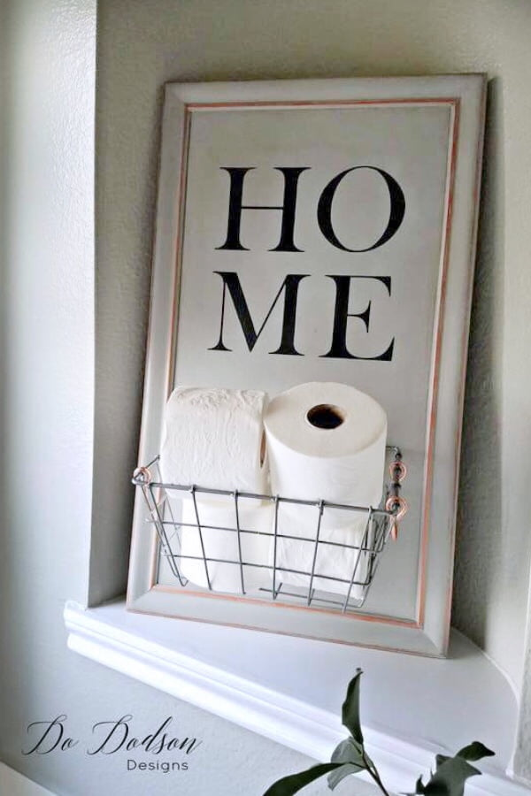 Try this easy DIY toilet paper caddy made from a repurposed cabinet door.