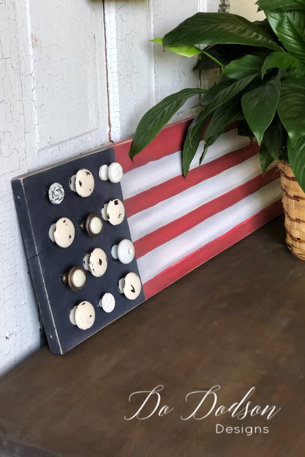 Wooden American Flag sign made from repurposed vintage knobs.