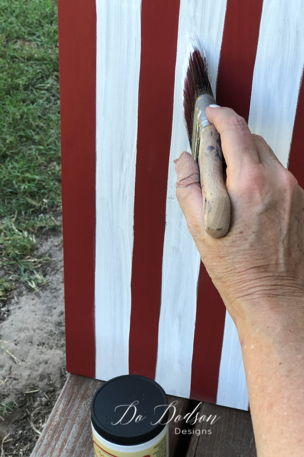 Red, white and blue on an DIY wooden American Flag sign.