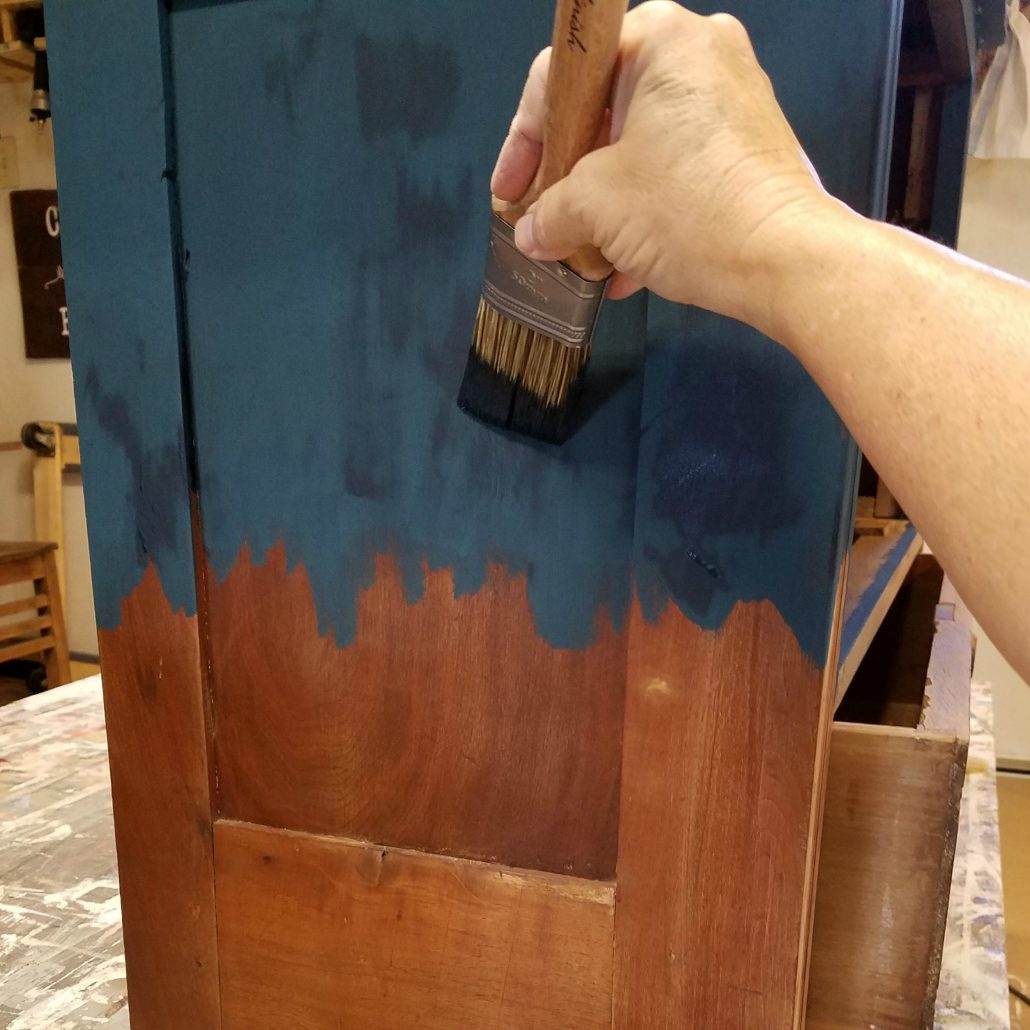 I added a beautiful blue paint to this dresser before adding my artistic touches. I'm gonna use my hands for the next step.