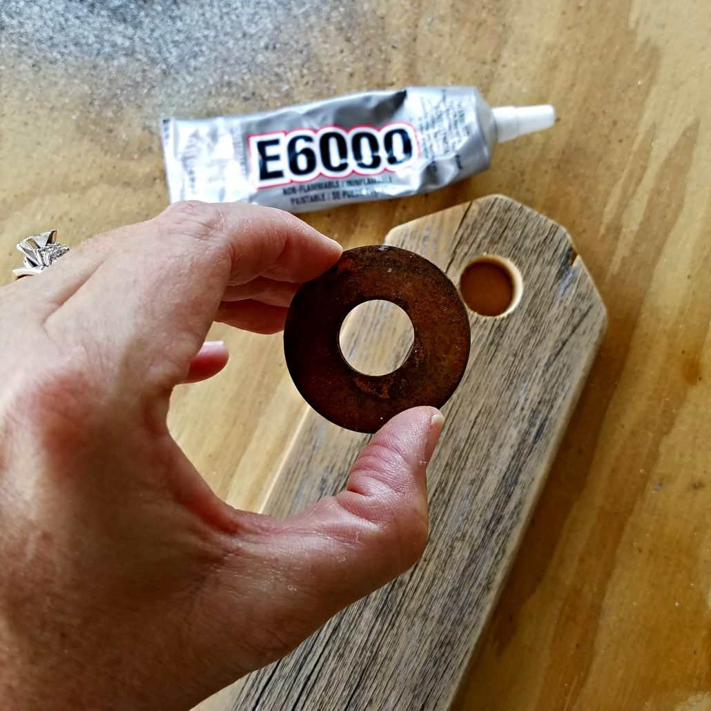 I added DIY rusty washers to old fence pickets to make wooden tags. #woodentags