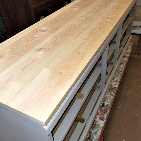This wood dresser/bench project is getting a brand new look with a beautiful stained top.