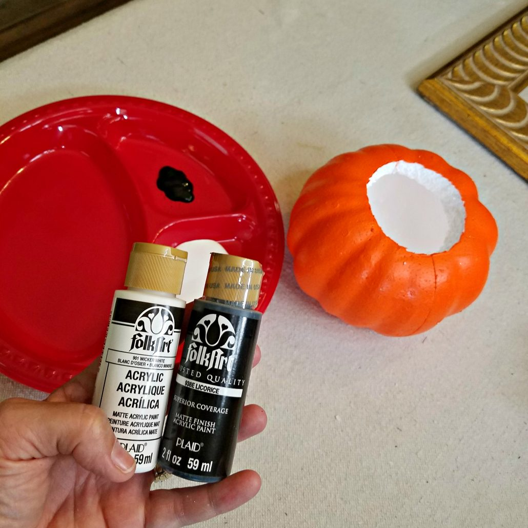 You'll need craft paints for this simple DIY Faux Concrete Pumpkin makeover.
