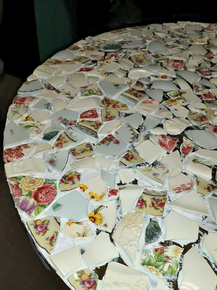 I strategically placed the broken pieces of the china on the table to fit like a well planned out puzzle. The mosaic table is coming together nicely.