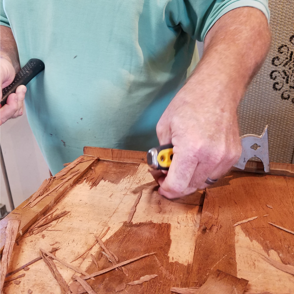 Dealing with veneer damage can be tricky, but very doable. Removing veneer from a wood dresser. #dododsondesigns #veneerdamage #veneerremoval