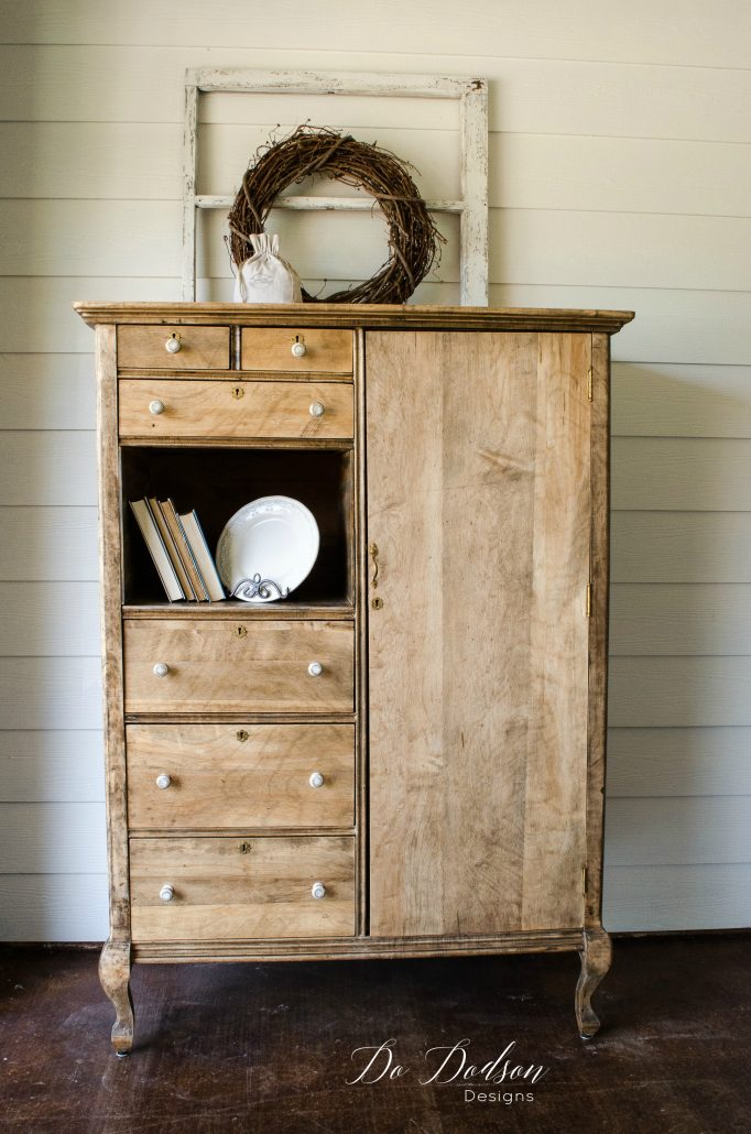 Raw wood farmhouse style armoire.