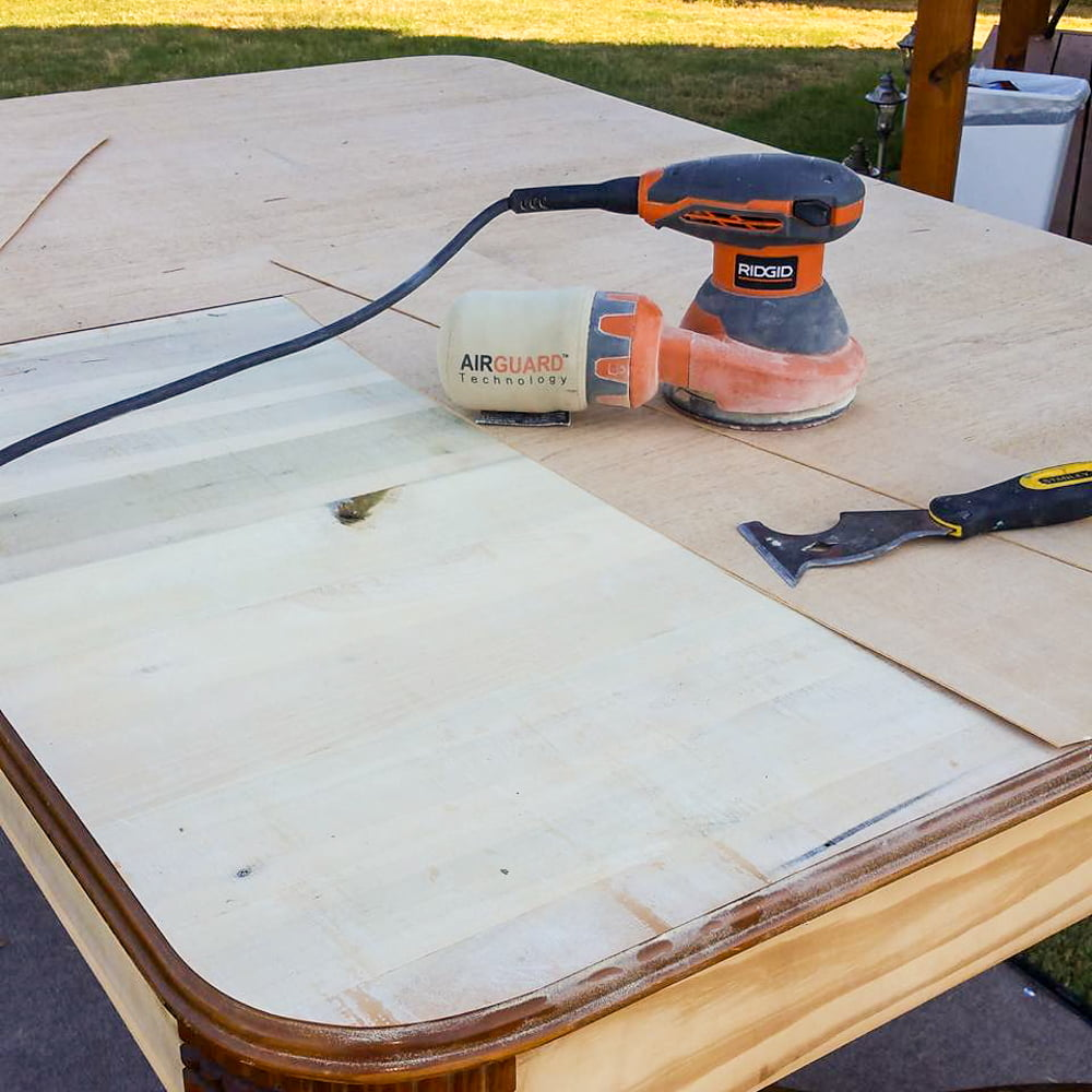 After removing all the veneer, I took my saw and cut grooves in the wood to create a faux plank table top on this farmhouse kitchen table.
