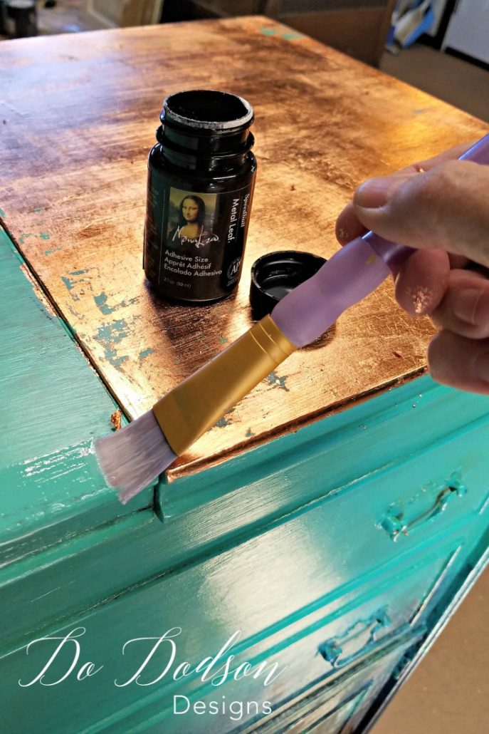 I applied the glue to the areas I wanted the gold leaf to adhere to on my painted furniture.