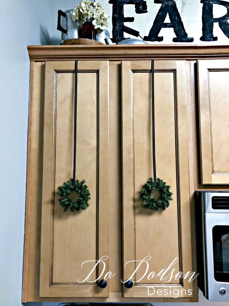 I used mini wreaths on my kitchen cabinets for Christmas.