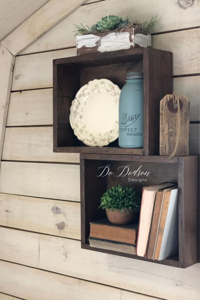 Vintage wooden crates make great decorative shelves for any space.