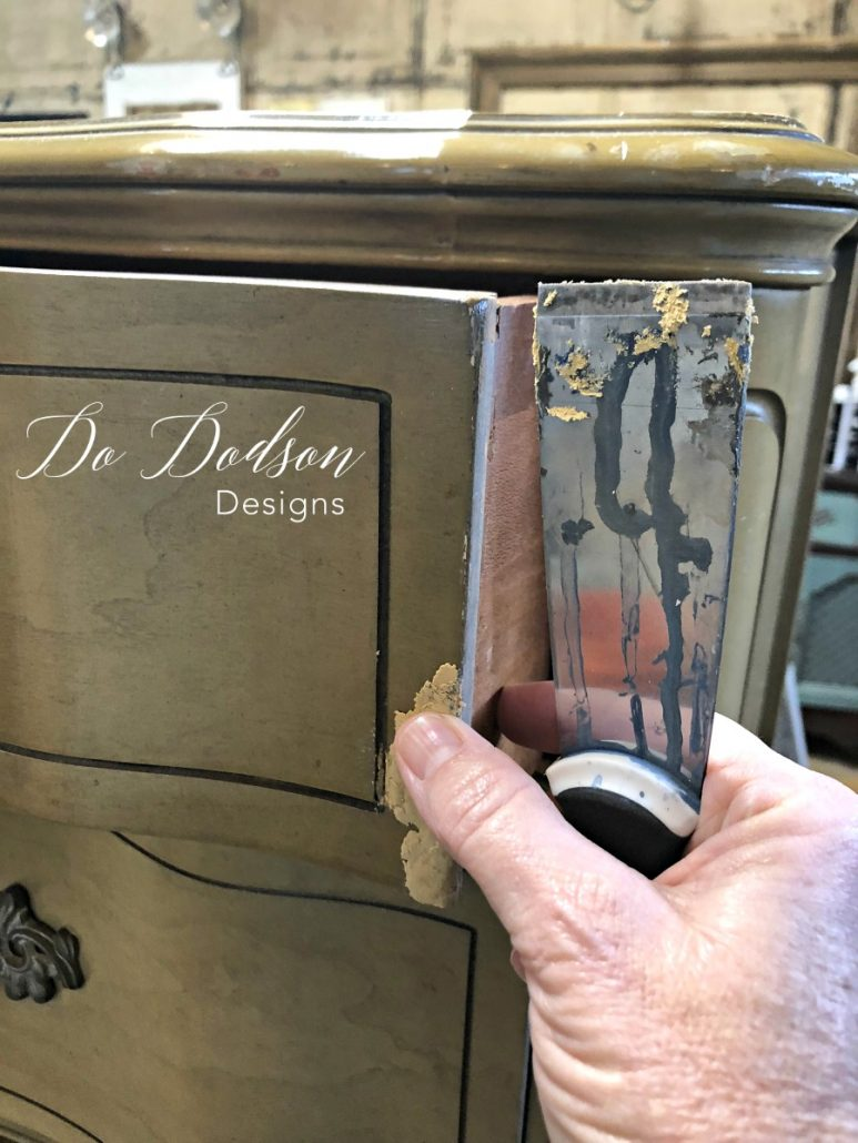 I use my finger to make sure the wood filler is in good contact with the damaged area. #dododsondesigns #woodfiller #furniturerepair