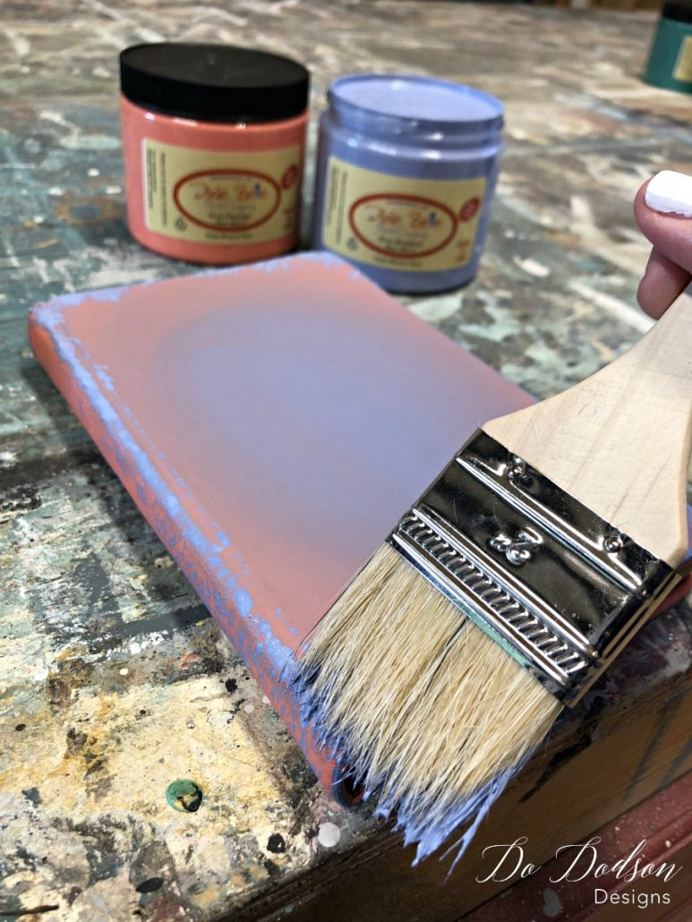 With a chip brush I added a contrasting chalk paint color to the corners of the painted book for a vintage look.