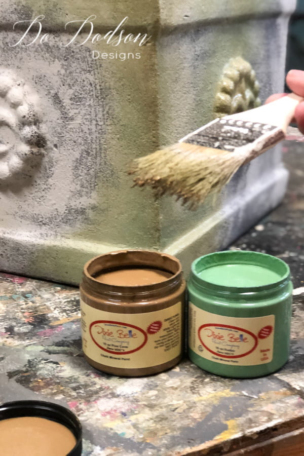 Using two colors of chalk paint I blended them together to create an aged and weathered look on these terracotta pots.