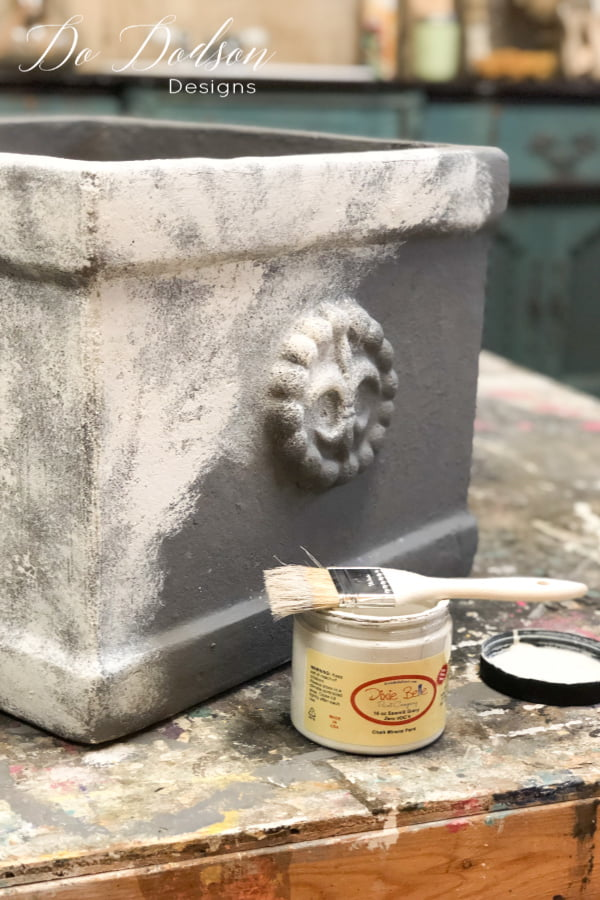 After the base coat of chalk paint is dried I added a second color to create a concrete look on my terracotta pots. I used a technique called stippling with my chip brush. Apply a small amount on the tip of the bristles of the brush and dab it on with an up and down motion instead of the back and forth. You don't want full coverage on this step.