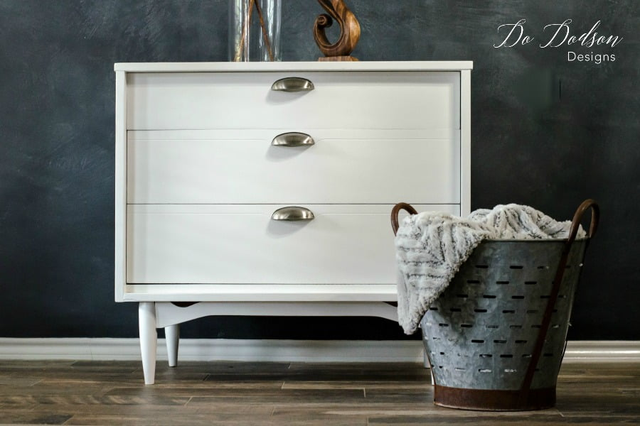 Using white paint on this mid century modern piece added a clean look. Consider a neutral color for your next furniture painting project.