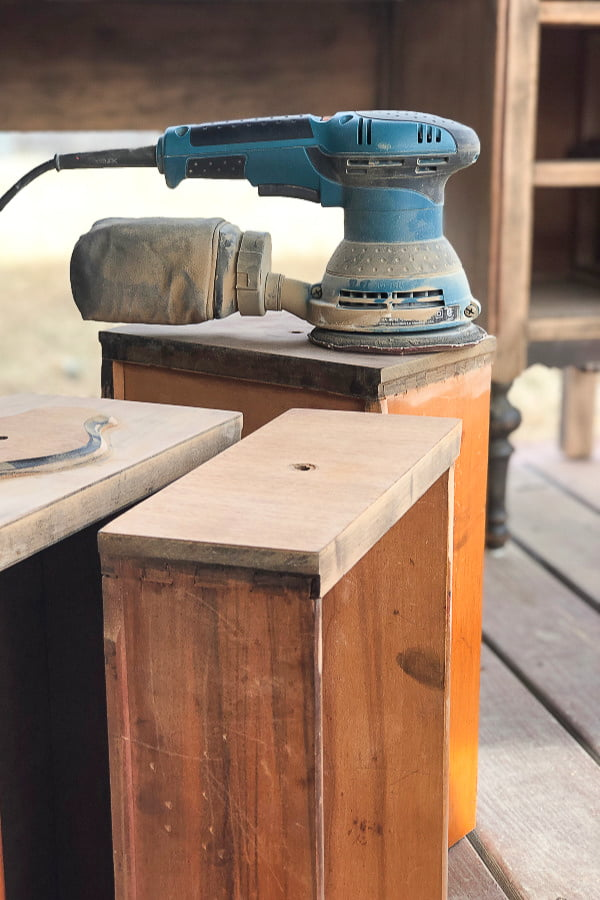 An electric sander is a must when you're sanding an existing finish down to get a raw wood furniture look.