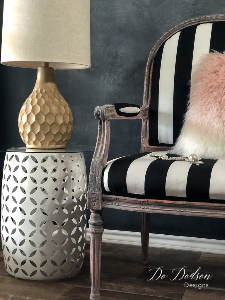I love how the bold black and white stripes complement the aged finish on this chair makeover