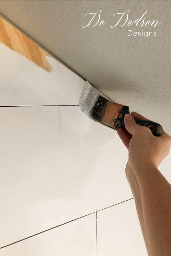 Painting with a real great primer is key when painting over plywood used to create a faux shiplap wall.
