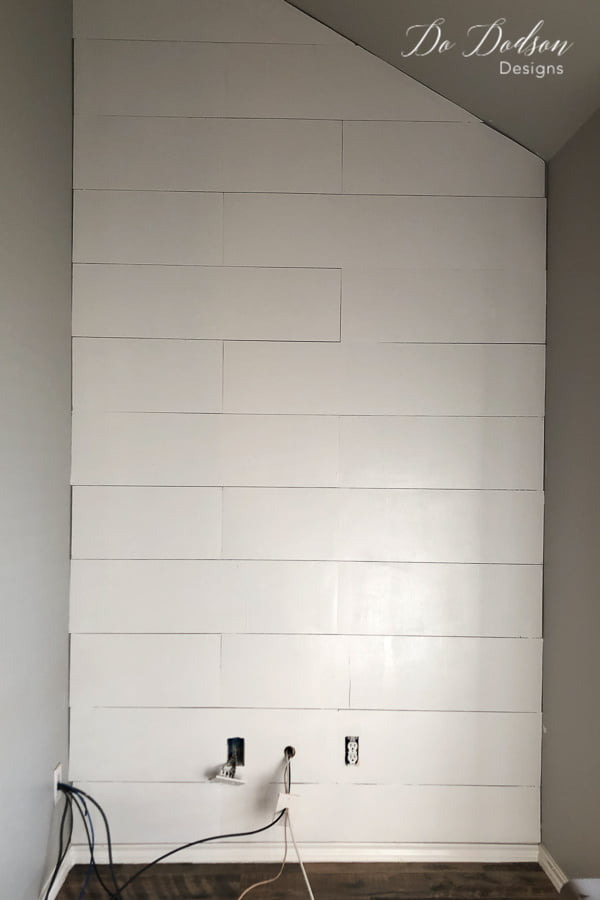 Always use a good quality flat paint when painting a faux shiplap wall made from plywood.