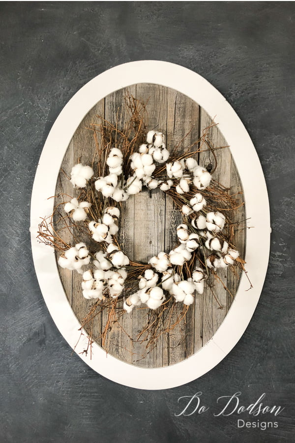 Reclaimed wood and a frame from an old mirror is all you need to create a beautiful home decor sign or use it as a place to hang your favorite wreath.