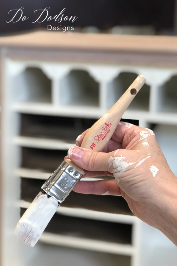 When painting the inside of a vintage desk, you need the right paintbrush for the job.