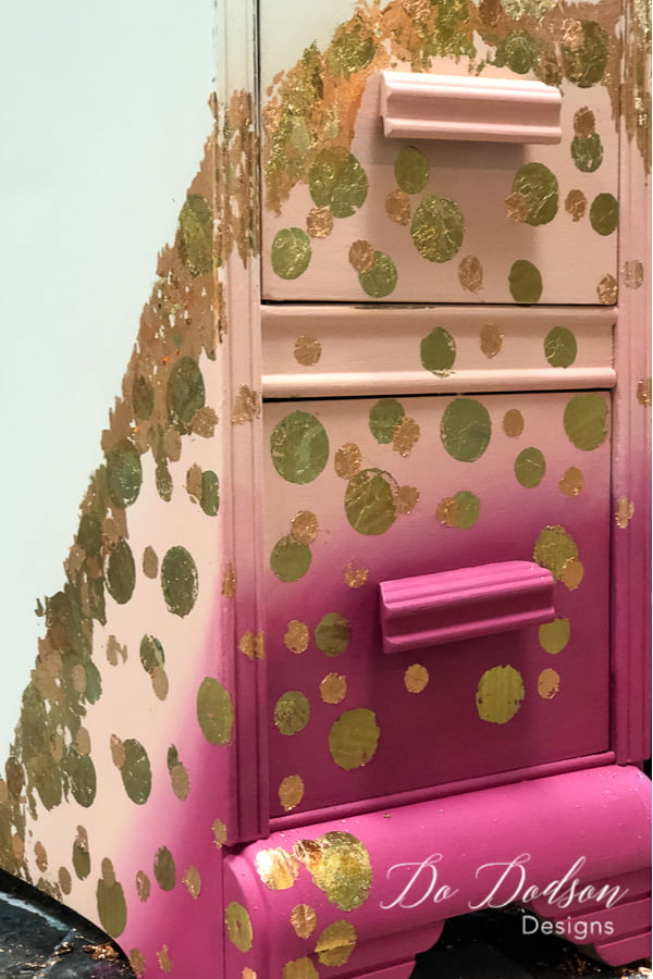 Gold and copper leaf polka dots on a pink painted nightstand.