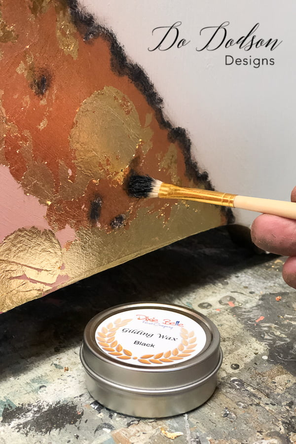 Black gilding wax added to copper and gold leaf.
