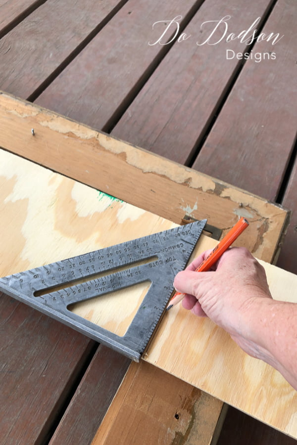 Measure the plywood to fit inside your upcyled picture frames.