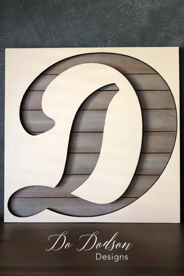 Custom painted wood letter cutouts with a faux painted wood backer board.