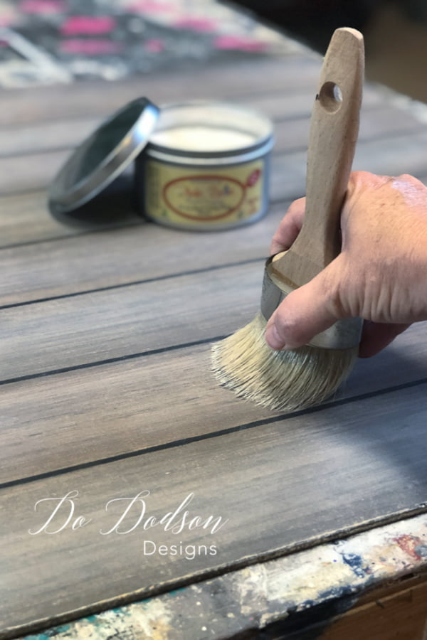 Next, I used a white wax to give the faux wood an aged appearance.