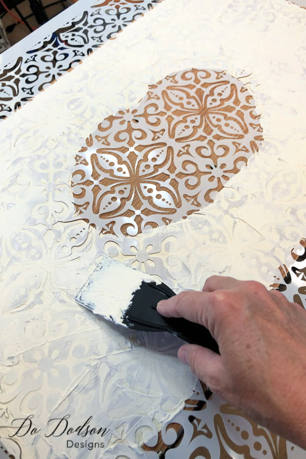 To apply a raised stencil on your furniture, you will need a few items. A beautiful 3D stencil and some mud.