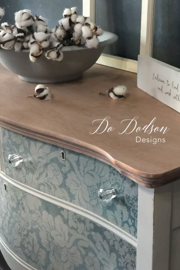 I love a raw wood finish on furniture and I got this look with white wax. Looks great with the decoupage paper I chose.