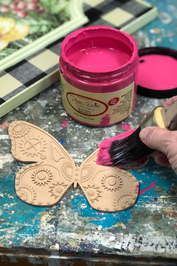 I painted the wood applique before gluing it in place on the cabinet door.