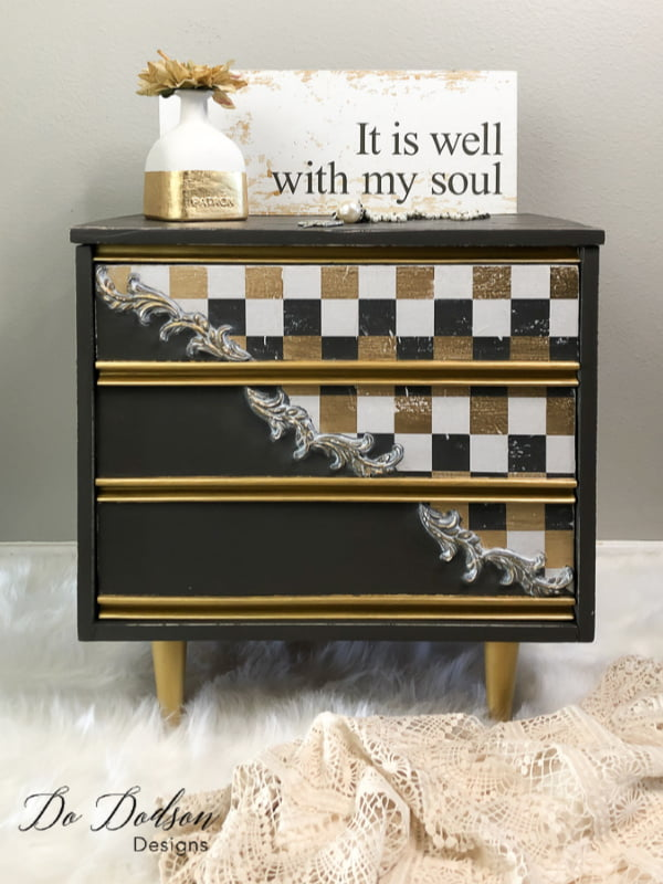 The combination of gold, gray and white checkered paper on this whisical furniture makeover is over the top amazing!