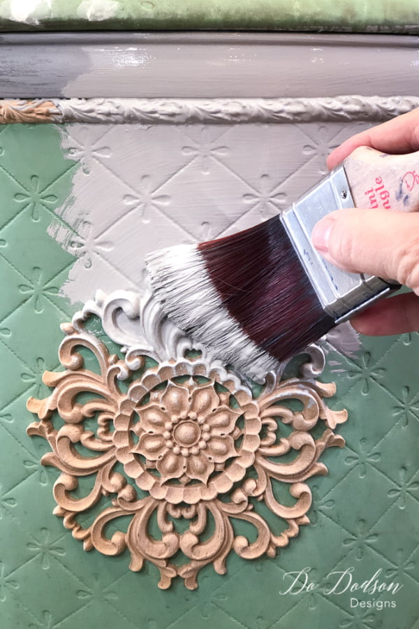 I used a chalk mineral paint over the wood applique medallion.