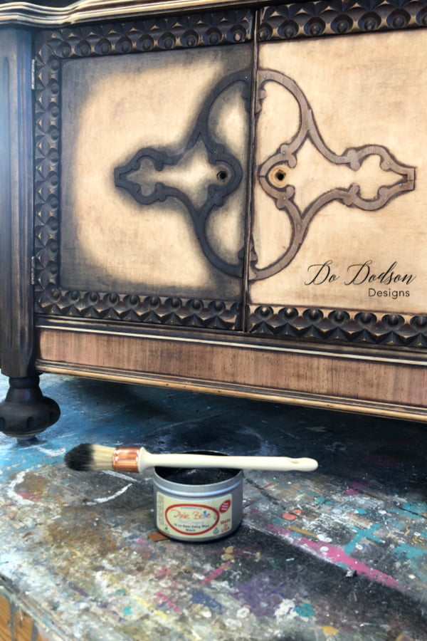 Adding black wax to this old piece of furniture will bring back the beauty of the wood.