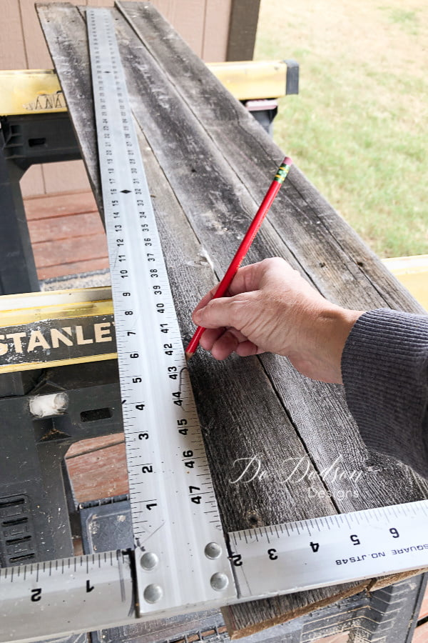 Before creating my tiny rustic churches, I measured and cut my boards to the height I wanted.