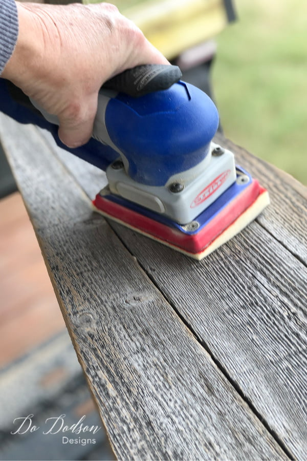 I used my Surfprep sanding system to smooth out the rough edges of the repurposed fence boards before painting.