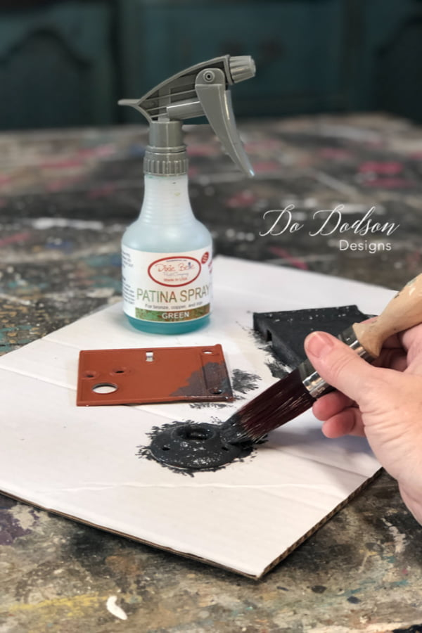 Next, paint over the metal hardware with two coats of Iron Patina paint. While the paint is still wet, spray over the Iron Paint with Green Patina Spray.