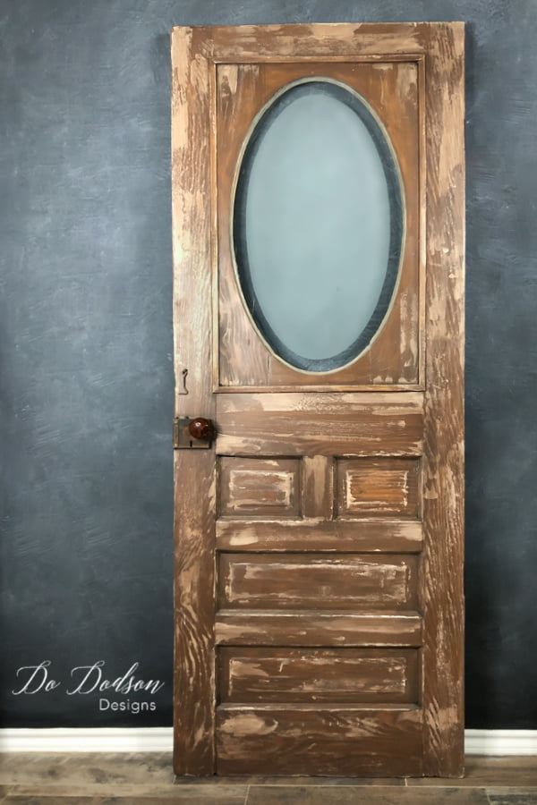 Adding a chippy paint technique to this antique door gave it a new life. This old gal is now the star of the home.