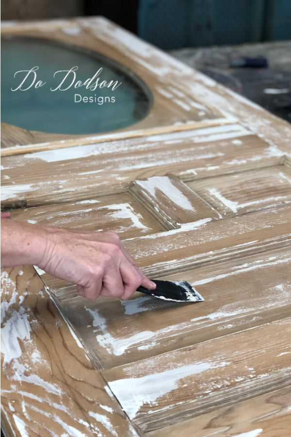 To add a chippy paint technique I used a plastic applicator to drap paint across the surface of the vintage door.