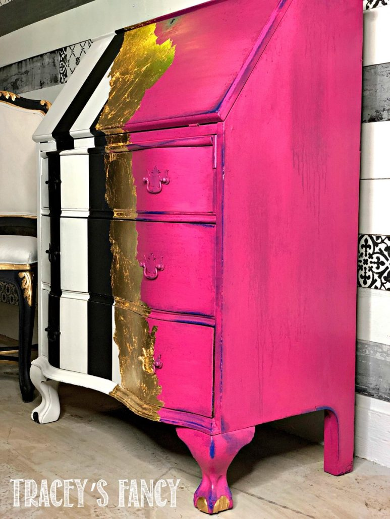 Hot pink gold meatl leaf furniture with bold accent stripes.
