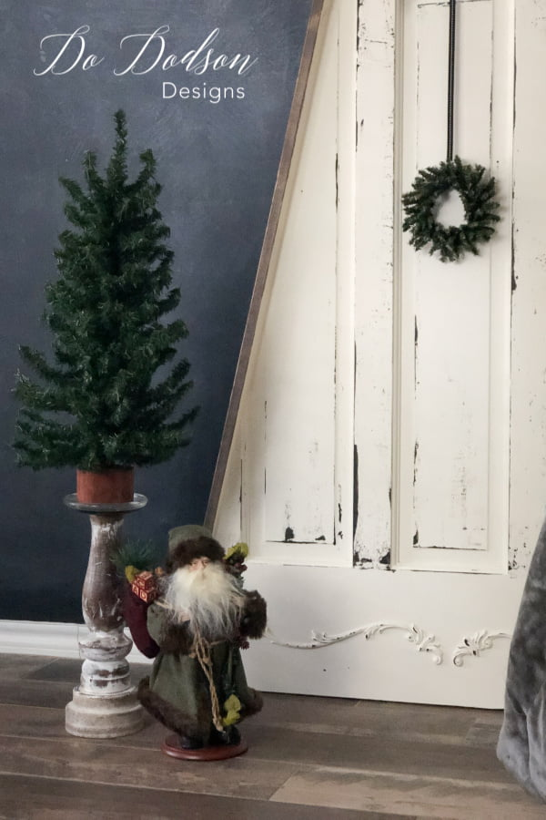 This was the best use of an old door! I cut it into the shape of a Christmas tree! It's perfect for small spaces.