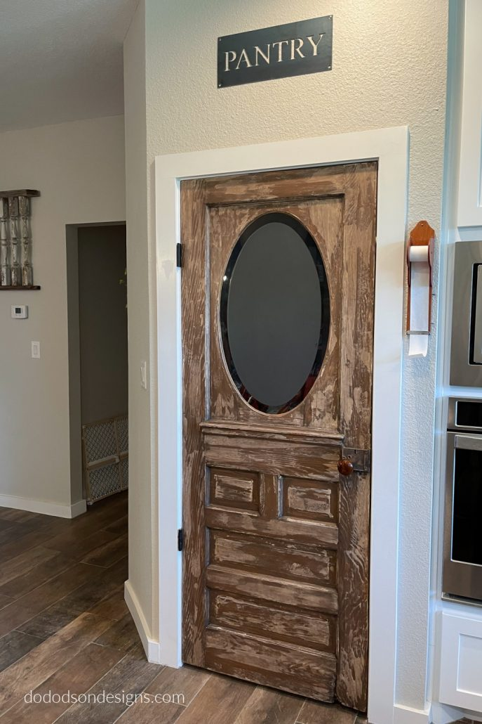 DIY Chippy paint finish on an old pantry door.