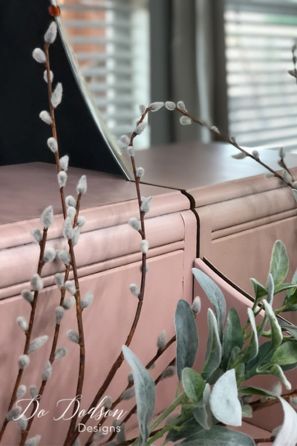 I love this beautiful pink finish on this old dresser.