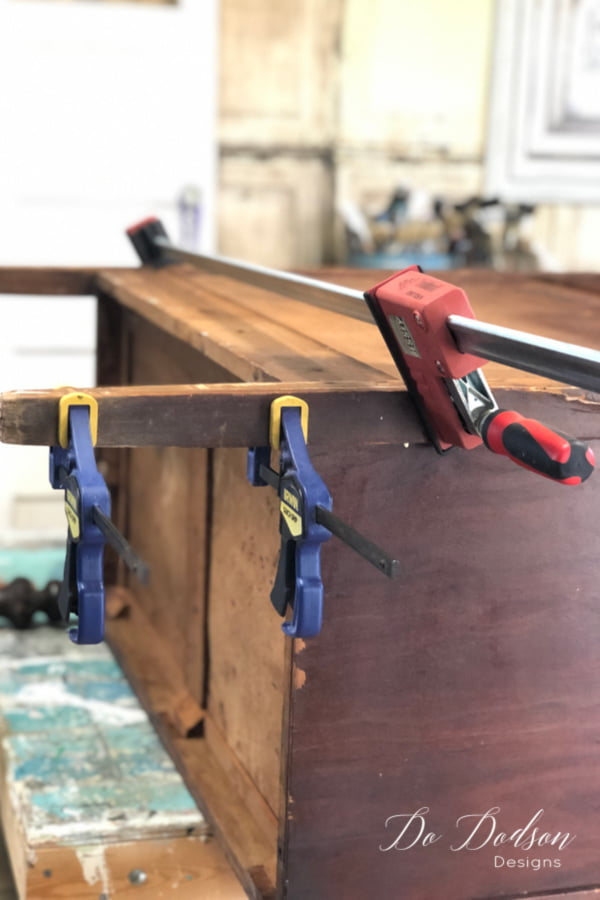 Once the wood pieces have been reconnected, secure with clamps until the glue is dried and the leg is back in one piece. Yay!
